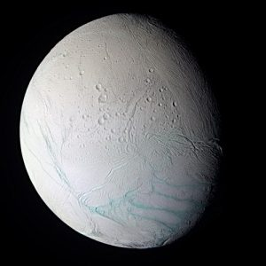 """Saturn's moon Enceladus with """"Tiger Stripes"""" fissures where geysers erupt"""